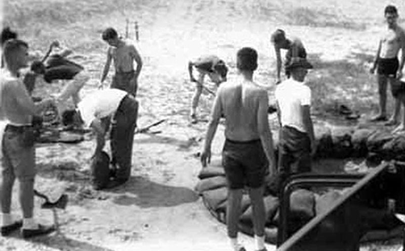 9. Da Nang AB, 366th SPS, K-9: K-9 handlers fortifying K-9 Fighting Hole. Gary Knutson, second from right. Don Poss is third from left. Photo by: Lee Miller, 1965-1966.