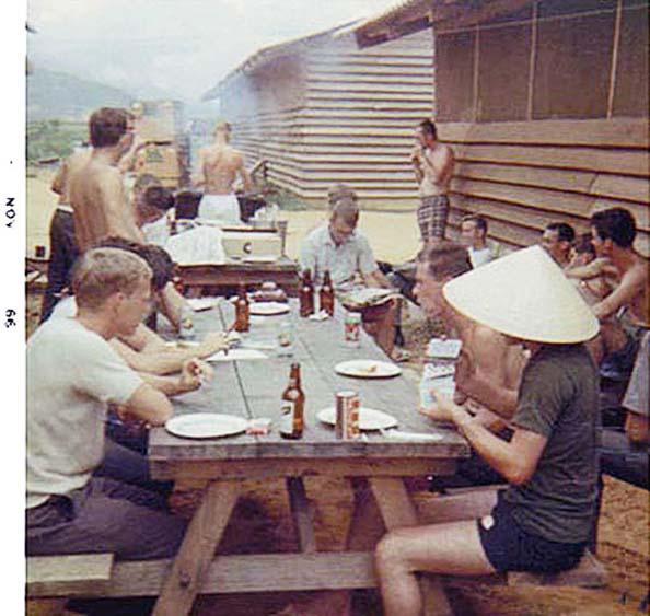 14. Da Nang AB, 366th SPS, K-9: K-9 handlers enjoy an off-duty BBQ. Photo by: Lee Miller, Nov 1966.