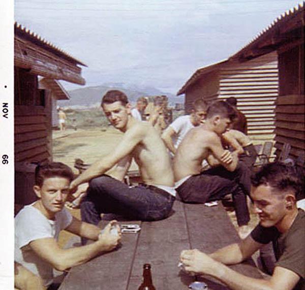 15. Da Nang AB, 366th SPS, K-9: K-9 handlers enjoy an off-duty BBQ. Photo by: Lee Miller, Nov 1966.