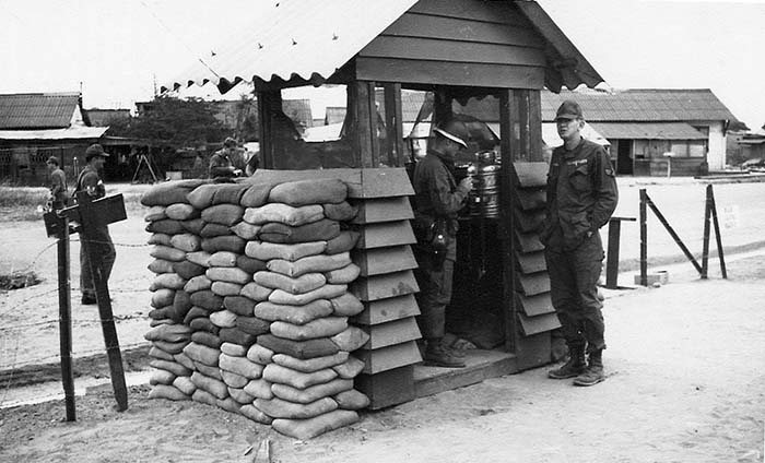 2. Da Nang AB: 366th SPS hut compound Access Gate. Across the street, ARVN housing. Photo by Ronald A. Perez, 1967.