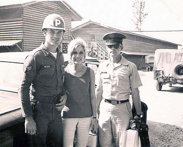 5. Da Nang AB: 366th SPS. Actress and singer Nancy Sinatra and LT escort officer, pose with A1C Mejer. Photo by Ronald A. Perez, 1967.