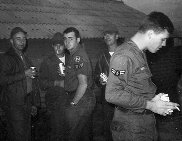 11. Da Nang AB: 366th SPS. Airman relax after rocket attack. Photo by Ronald A. Perez, 1967.