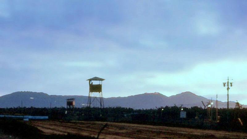 1. Da Nang AB, Perimeter Tower. Monkey Mountain in distance. Photo by: Ronald A. Perez, DN, 366th SPS, 1966-1967.
