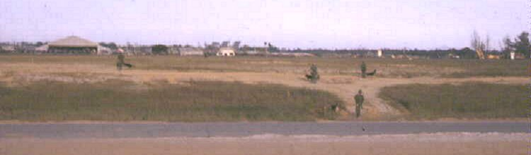 Da Nang AB, AF K-9 post along the only runway at that time. S/E perimeter of this story can be seen at photo's top-right in distance; by Don Poss, K-9