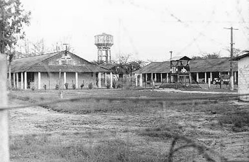 12. Da Nang AB, VC-NVA POW Camp near main gate. QC Tower in camp. Water Tower in background. 1966-1967. Photo by: Ron Westering, LM 431, DN, 366th SPS; DET MM, 1/366th SPS. 1966-1967.