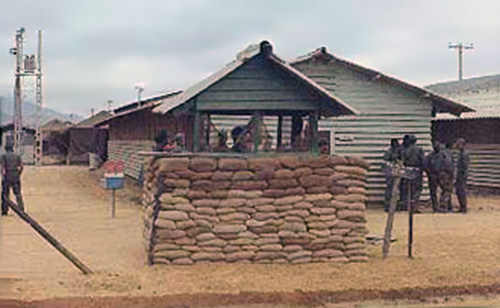 1. Da Nang AB: 366th SPS, New Huts replacing still used tent-city in background. Improved SP Access Post Bunker. Photo by Ron Westering, 1966-1967.