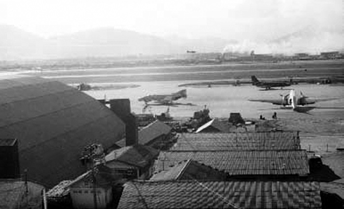 5. Da Nang AB: 366th SPS, Mid flight line view to west, with part of Freedom Hill 327 visible. Both runways are fully constructed and active. Photo by Ron Westering, 1966-1967.
