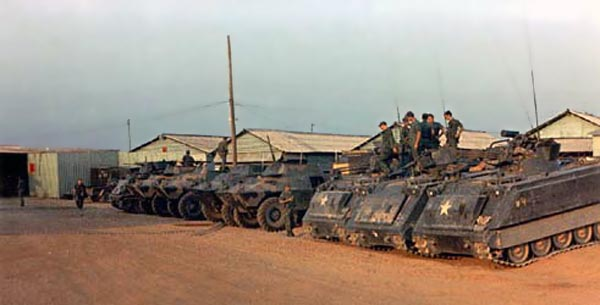 1. Bien Hoa AB, Security Police M113 APC (right), and V100s (left). Photo by: Ernest Govea. 1968-1969.