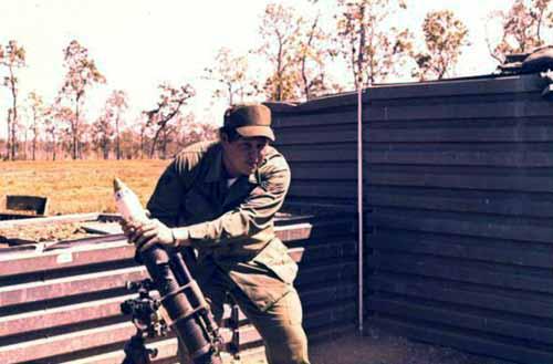 4. Korat RTAFB: Sgt David Worthen, firing mortar. 1972-1973. Photo by: David Worthen, BH, 3rd SPS; KRT, 388th SPS. 1969-70; 1972-73.