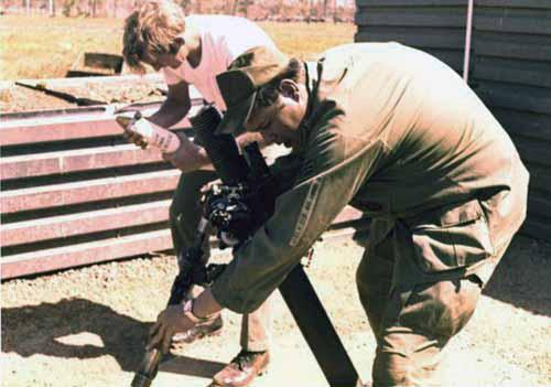 5. Korat RTAFB: Sgt David Worthen and Sgt Hicks, aiming gun. 1972-1973. Photo by: David Worthen, BH, 3rd SPS; KRT, 388th SPS. 1969-70; 1972-73.
