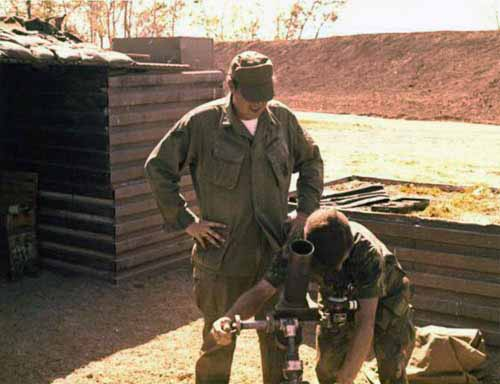 3. Korat RTAFB: Sgt Stillwell and Sgt David Worthen, aiming mortar. 1972-1973. Photo by: David Worthen, BH, 3rd SPS; KRT, 388th SPS. 1969-70; 1972-73.