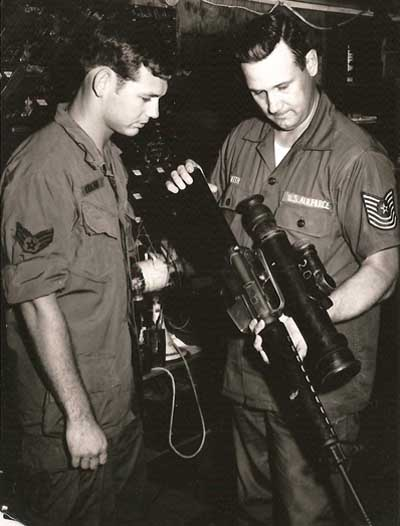8. MSgt Smith (right) demonstrates an M16 with Starlite Scope. USAF Photo via Don Bishop 1969-1970.