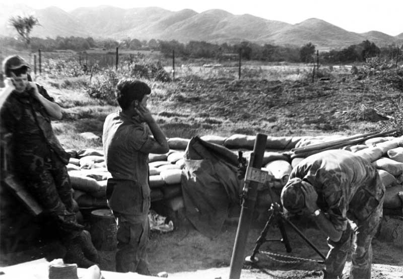 12. Phu Cat AB, Here's one of the 81mm mortar in action, Cobra Flight, Charlie 10, Phu Cat. 1968-1969. Photo by: Mike Sipes, PC, 37th SPS, 1968-1969.