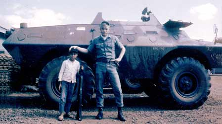 5. Pleiku AB, V100. Larry Sutherland, with boy. Photo by: Clifton Larry Sutherland (RIP), PR, 822nd CSPS, 1968-1969.