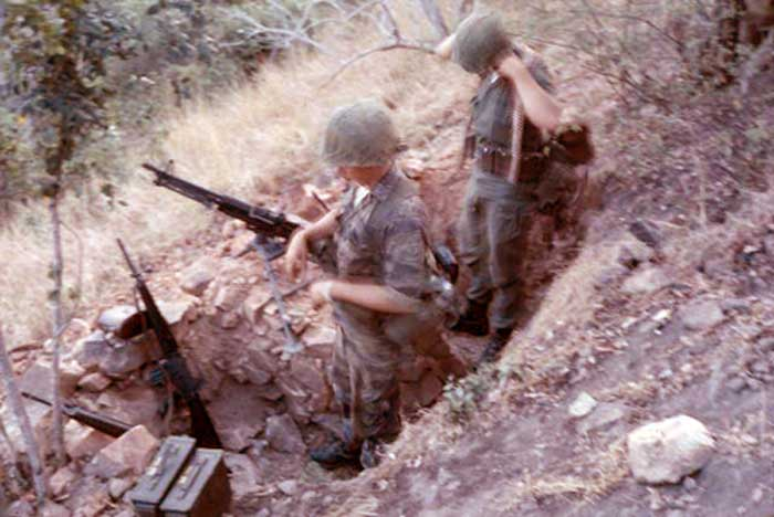 9. Phan Rang AB: Operation Nui Dat. Preparing for the night as the post was only manned dark to daylight. We walked up and walked down the Hill in those days. 1966. Photo by: Newell Swartz, LM 262, PR, 35th SPS; PC, 37th SPS, 1966-1967.