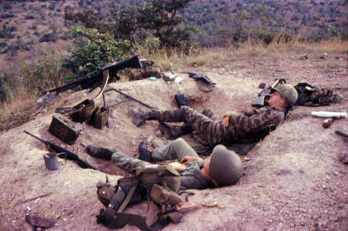 10. Phan Rang AB: Operation Nui Dat. Sprawled out and taking a break a little break in the warm sunshine because, believe it or not, it got cold sometime up there on the hill at night, especially if it was raining and the wind blowing. 1966. Photo by: Newell Swartz, LM 262, PR, 35th SPS; PC, 37th SPS, 1966-1967.