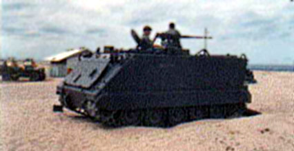 10. Tuy Hoa AB, M113, with .50cal machinegun, and Bunker with M-60. Photo by: Domenic Sebben, NT, 14th SPS; TUY, 31st SPS, 1969-1970.