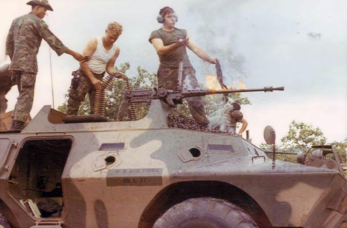 3. Ubon RTAFB. V100 .50cal. machinegun. Barrel on fire! L/R: Thai Guard, Walker, James Wilson. 1971-1972. Photo by: Everett (Willie) Squires,UB, 8th SPS, HW, 1971-1972.