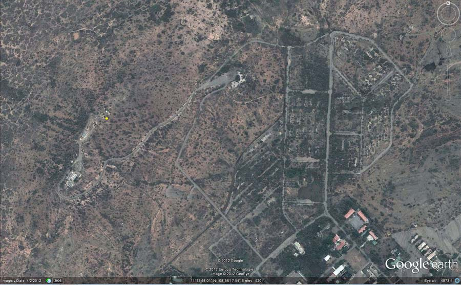 2. Google Satellite image (current): Nui Dat base and compound roads and old foundations can still be seen. The yellow dot (center/left) marks Nui Dat hill's elevation of 520 feet.