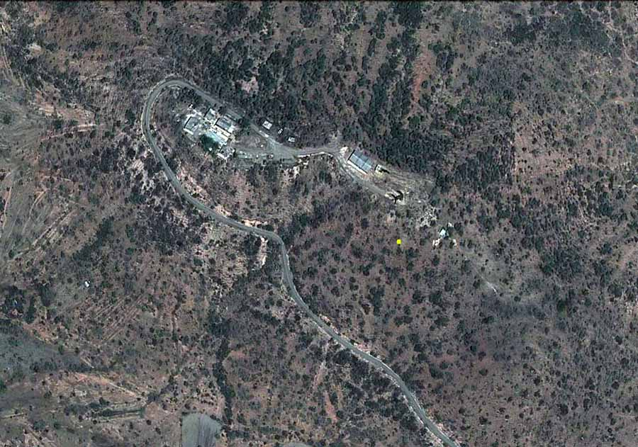 6. Google Satellite image (current): Nui Dat hill, overhead view. Yellow dot marks 180.30 meters high.