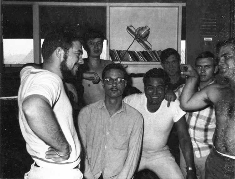 9. Nui Dat: 35th SPS tent-huts 1967. Seems that group pictures occassionally had someone flipping the bird. In this case, the guy in the pladd shirt is yours truly, Stan Reeves. Photo by Stan Reeves, ND 1967.