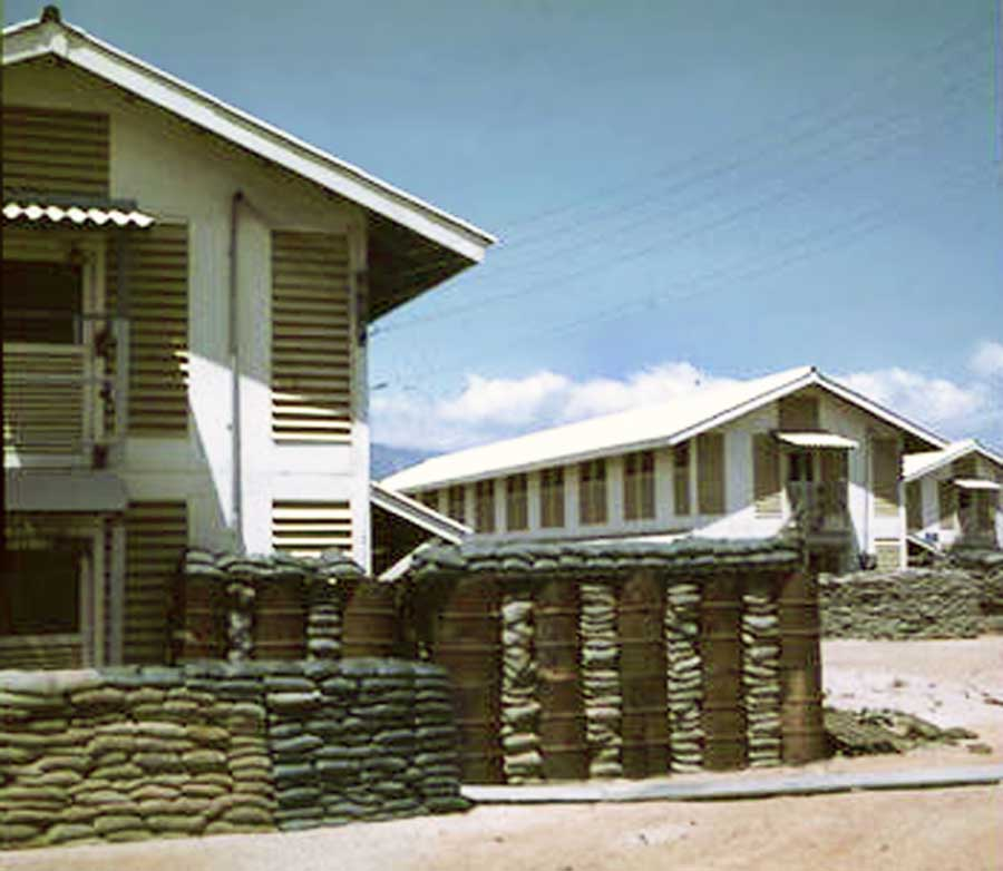 11. Nui Dat: 35th SPS. With barracks construction, followed sandbag and bunkers details. I wonder what the barrels had contained? Photo by Stan Reeves, ND 1967.