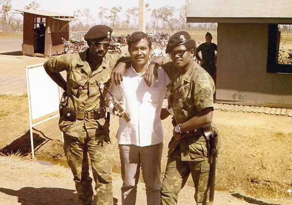 2a. NKP Main Gate: Sgts Davenport and Clement, with the LE interpreter, Mr. Daisha (An Indonesian). Photo by: Roderick K. Duncan.
