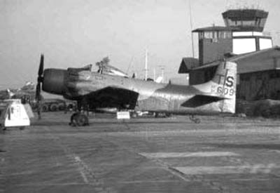 11. NKP Control Tower, above tail of parked A1E Spad. Photo by: unknown.