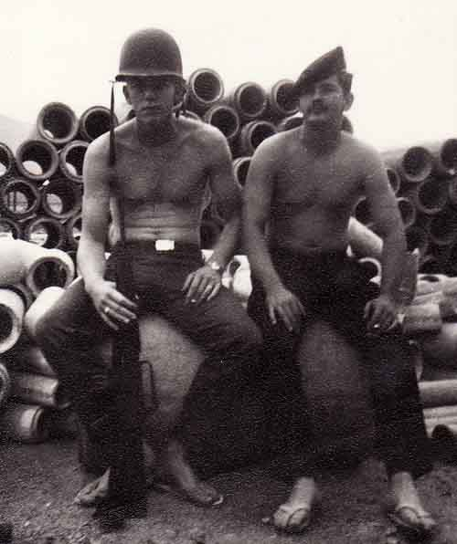 Photo #3 (Nha Trang): This was taken behind the hooches prior to moving into the new concrete barracks. Pictured with me (on left) is A2C Earl Mercer, who lived in the same hooch as I did.