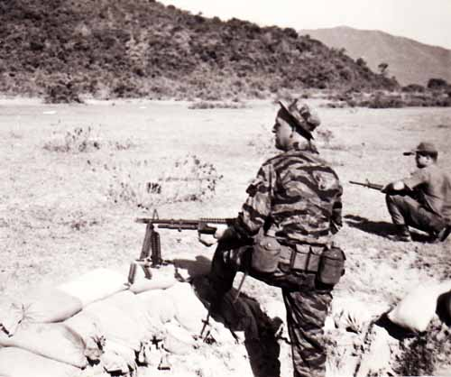Photo #7 (Nha Trang): Another shot while at the firing range. The AP on the M60 is unknown. Standing is SSgt Roger Rude, NCOIC of the Armory.