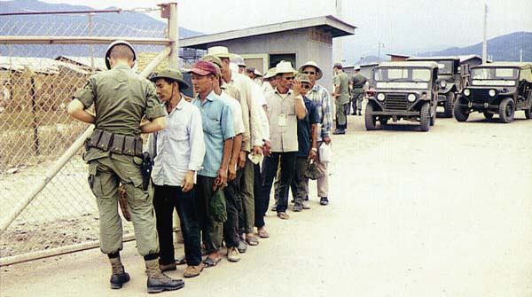 13. Nha Trang AB Gate Post-4. Civilian workers being screened. Photo by: Tony Niemotka, LM 577, NT, 14th SPS, 1968-1969.