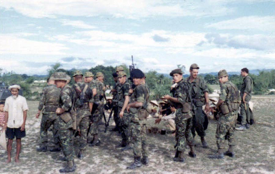 5. Phang Rang AB: M113 left-center. Cobra Flight talk to Vietnamese. Photo by Brian Williams, 1967-1968.
