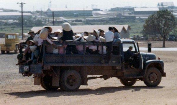 Vietnamese civilian workers coming to work.