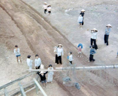 11. Phu Cat AB, Perimeter Tower. View from a Gate Tower. Civilian Vietnamese workers outside gate. Photo by: David Hayes, LM 462, CRB, 12th SPS; PC, 37th APS, 1967-1968.