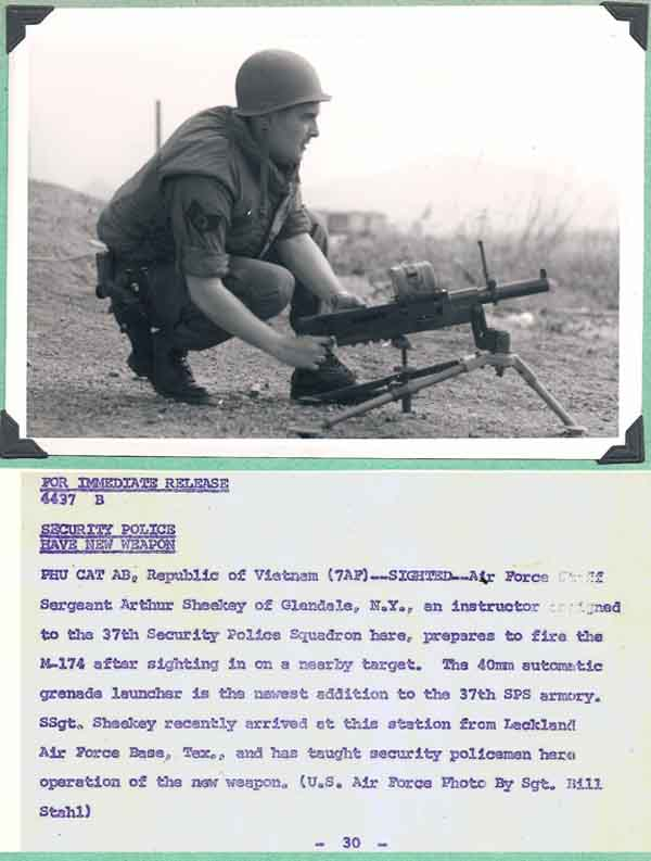11. Phu Cat AB, Immediate News Release: 37th SPS, Instructor Sergeant Arthur Sheekey Manns prepares to fire the M-174 auto grenade launcher weapon. Photo by Don Bishop. 1969-1970.