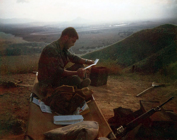 9. Phu Cat AB: Post 151, Doug Davis with mail, after chopper. Photo by: Doug D. Davis, 1968.