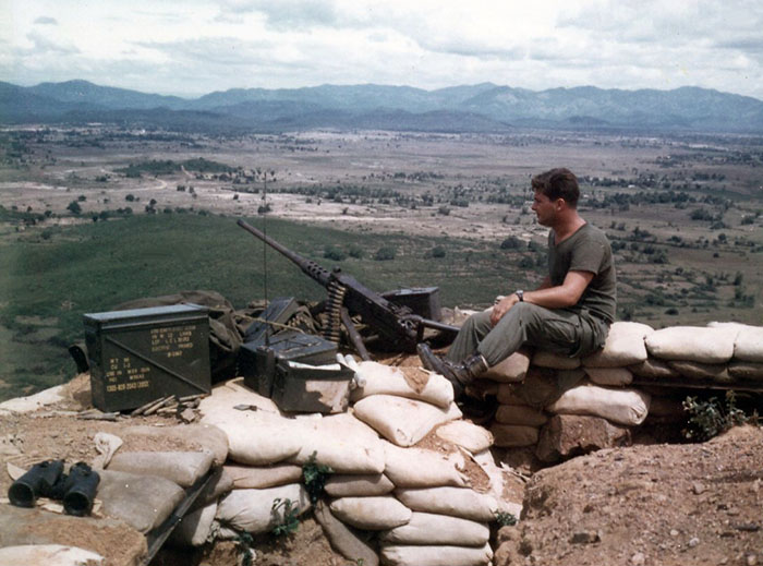 11. Phu Cat AB: Post 151, Doug Davis with .50 Cal, in the afternoon. Photo by: Doug D. Davis, 1968.