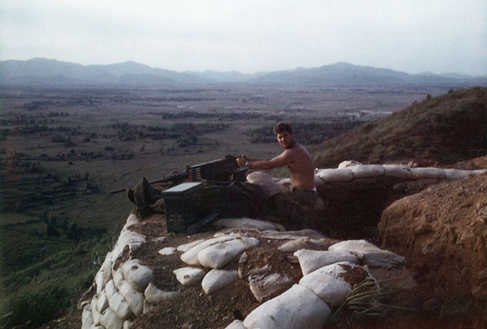 12. Phu Cat AB: Post 151, Doug Davis with .50 Cal, in the afternoon. Photo by: Doug D. Davis, 1968.