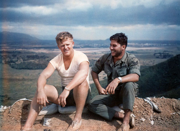 13. Phu Cat AB: Post 151, Nordburg and Doug Davis take a break. Phu Cat AB in background-center. Photo by: Doug D. Davis, 1968.