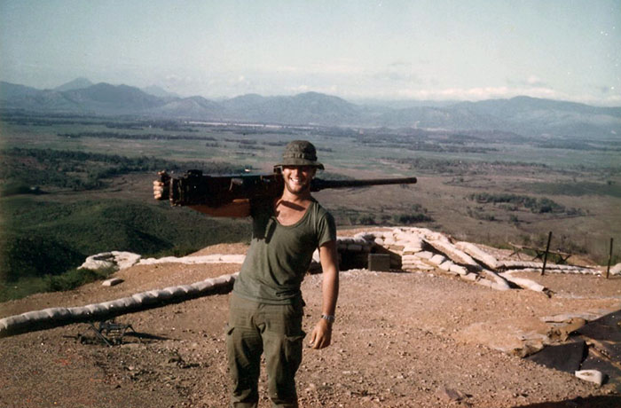 14. Phu Cat AB: Post 151, Doug Davis, K-9, carries Big Gun .50 Cal on post. Phu Cat AB in background-cente. Photo by: Doug D. Davis, 1968.