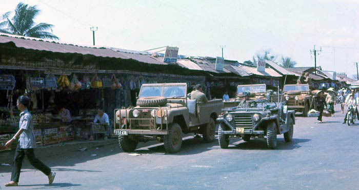 Phuoc Le market. USAF jeep with MSgt Summerfield, 1969: 05