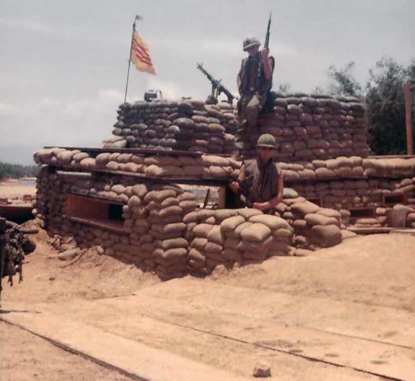 4. Phan Rang AB: Waterpoint Bunker, Outside of Base. M-50. Photo by Dana Anthony, 1968-1969. Note the USA Flag fluttering ontop of the South Vietnam flag!