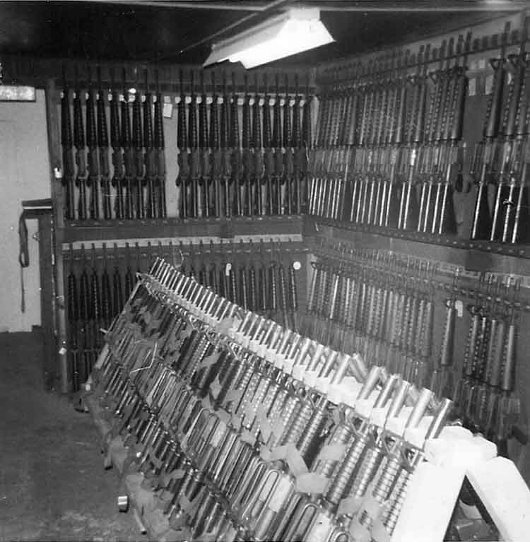 21. Phan Rang AB: Law and Security Weapons Room, M-16's Weapons Racks. Photo by: Van Digby, 1968.