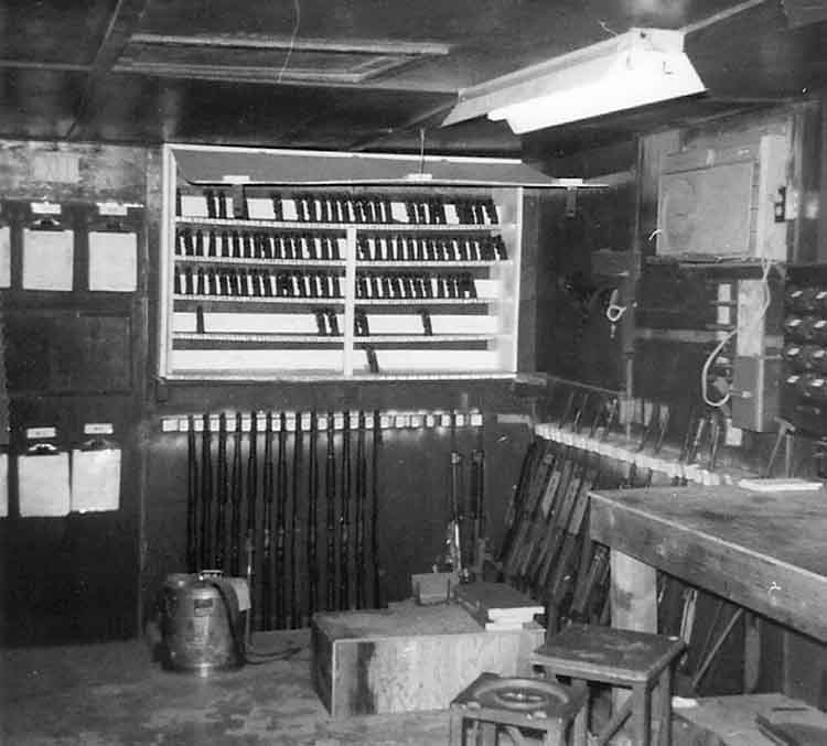 22. Phan Rang AB: Law and Security Weapons Room. Handguns, Shotguns and Weapons racks. Photo by: Van Digby, 1968.