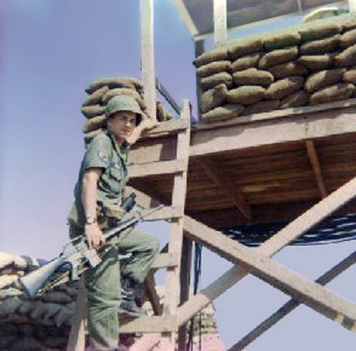 Photo: Terry Morris standing on Tower OP-1 ladder. 1966-1967.