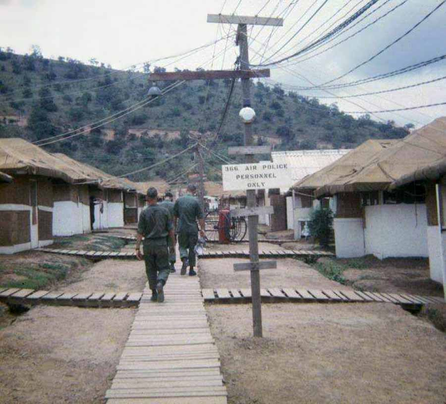 2. Phan Rang AB: Nui Dat Hill, 366th APS: Tent-Huts and wooden plank-walks for monsoon weather, with Nui Dat hill in background.