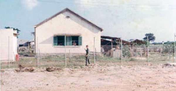13. Phan Rang AB: Road to town and Vietnamese housing. Photo by Gary Phillips. c1966.