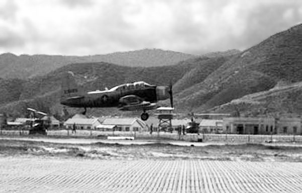 1. Qui Nhon AB, flight line Tower can be seen beneath the A1E Spad's propeller. Photo by: unknown.