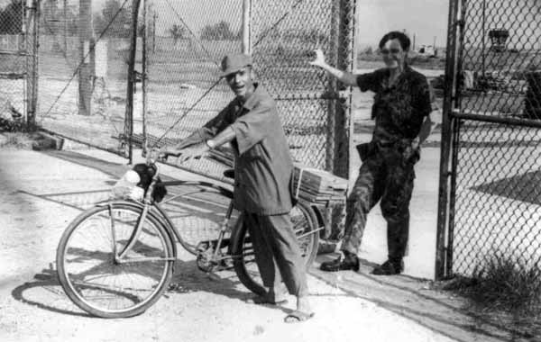 1. Tan My, Loran Station. Airman Bill Ashworth letting papasan out the TMY Main Gate. 1972. Note tower at upper-right. Photo by: Mike Thomas.