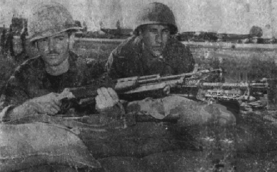 A2C Robert B. Kane and A2C Alvin C. Curie defend their post during the sapper attack of 4 Dec 1966.